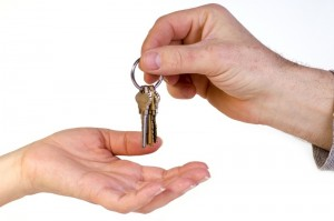 Person is giving keys to someone else